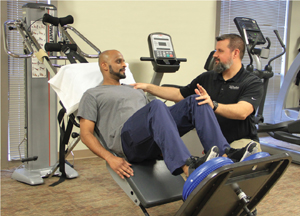 Dr. Rony Ninan and physical therapist Dan Kershner.