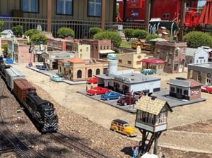 Miniature Rosenberg with a model train at the Rosenberg Railroad Museum. Source: www.rosenbergrrmuseum.org/garden-railroad.